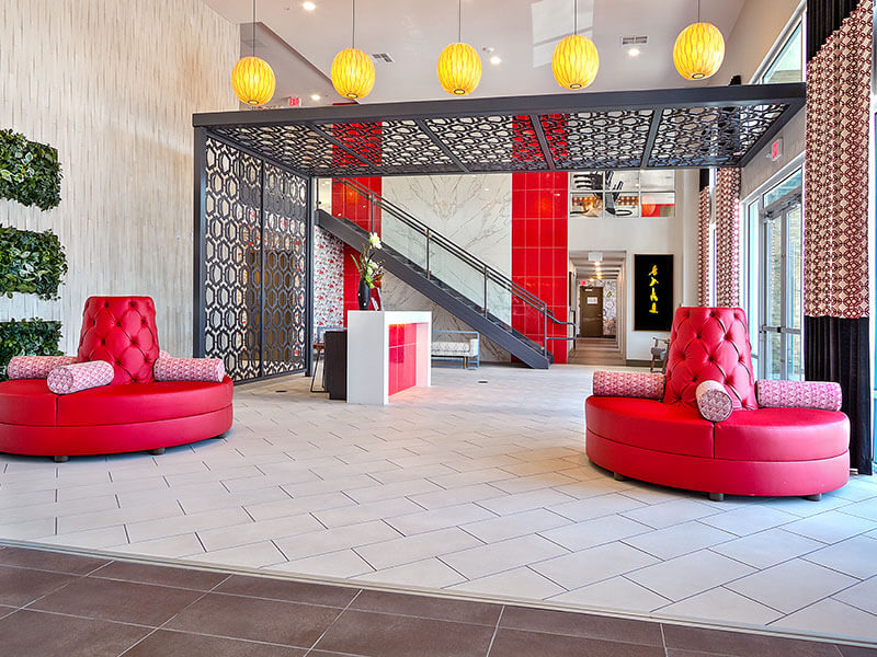 Red circular banquette seats in the lobby of Lotus